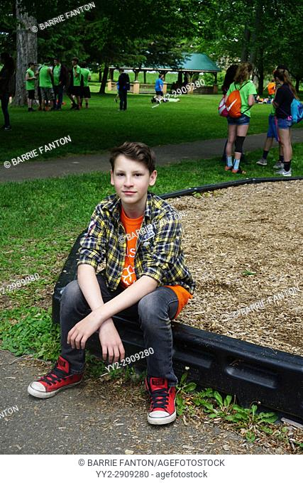 7th Grade Boy Sitting Alone, Wellsville, New York, USA