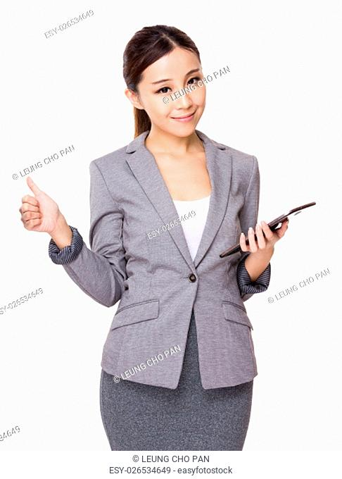 Businesswoman use of the tablet and thumb up