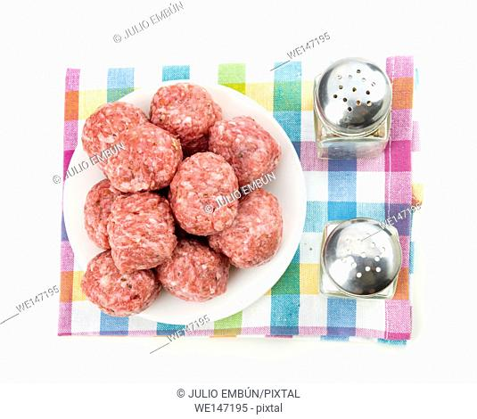 raw homemade meatballs prepared for cooking, isolated on white