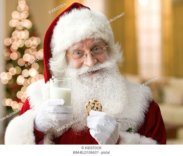 Santa having milk and cookies