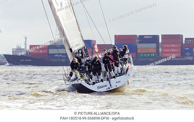 18 May 2018, Germany, Cuxhaven: Sailing crew of yacht 'Tutima', occupied with a female crew, are prepared on the estuary of the Elb river for the sailing race...