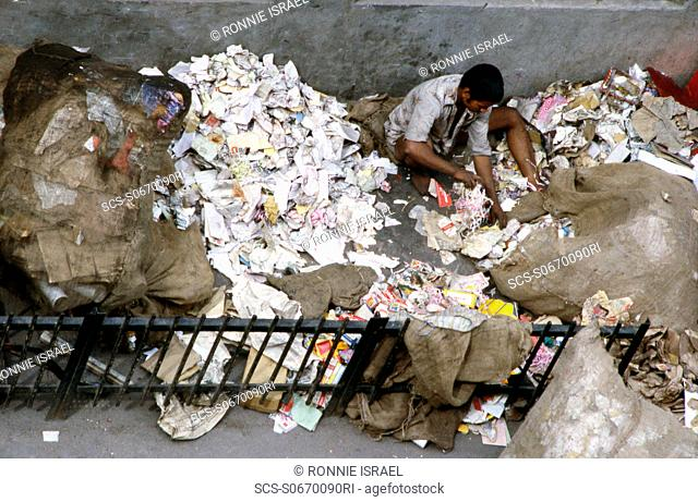 Sorting through waste paper India
