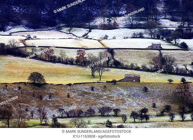 Barns on the slopes of Pen Hill Wensleydale Yorkshire Dales England
