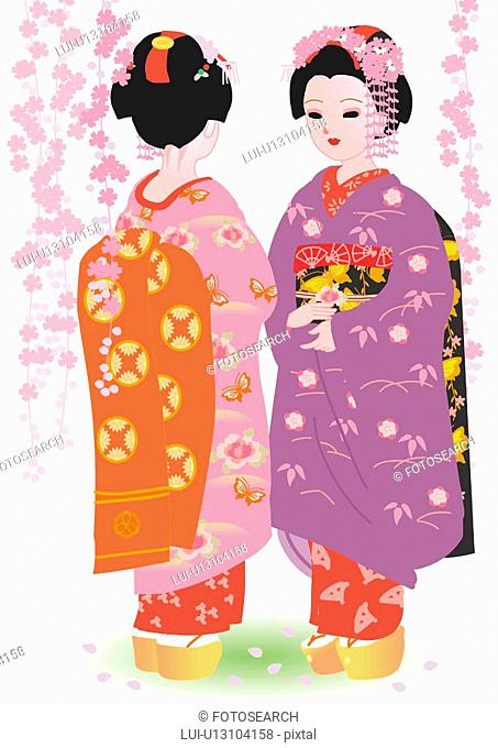 Two women standing and talking in Japanese style clothing, spring, Japan