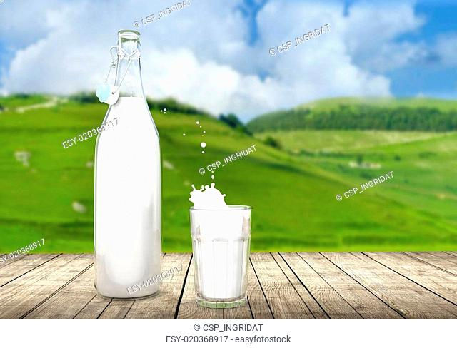 vintage bottle and glass of milk on wooden table