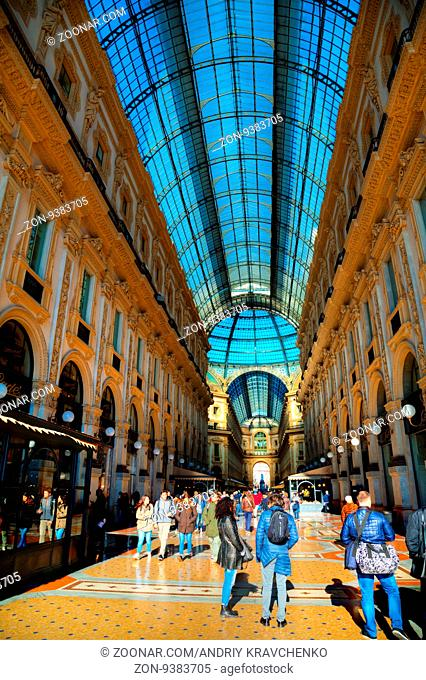 MILAN, ITALY - NOVEMBER 24: Galleria Vittorio Emanuele II shopping mall entrance with people on November 24, 2015 in Milan, Italy