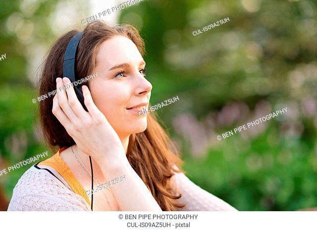 Woman wearing headphones looking away