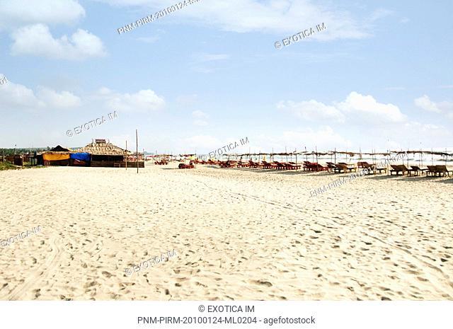 Lounge chairs on the beach, Goa, India