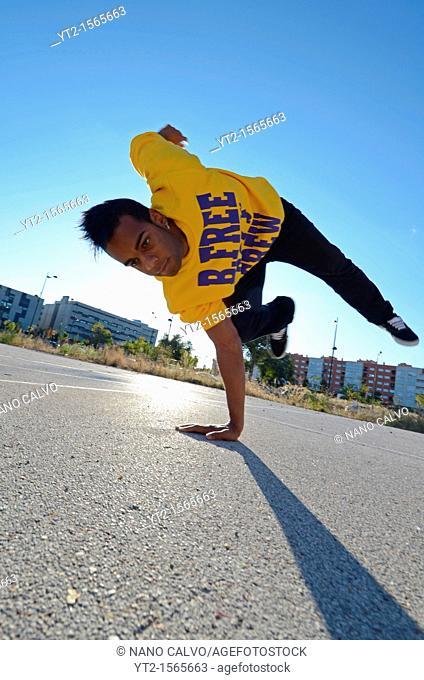 Breakdancer John Lartey performs in the street