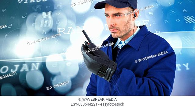 Composite image of focused security officer talking on walkie talkie