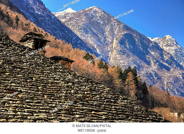 Stone roof and snow-capped mountain