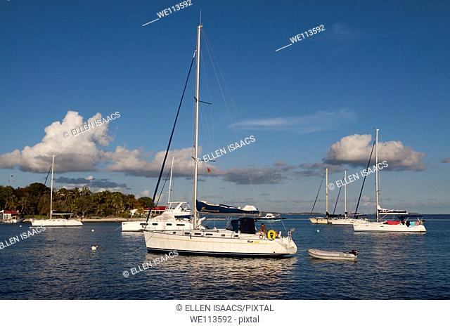 Sailboats moored in deep blue water in afternoon at Marina Cay in Tortola in British Virgin Islands
