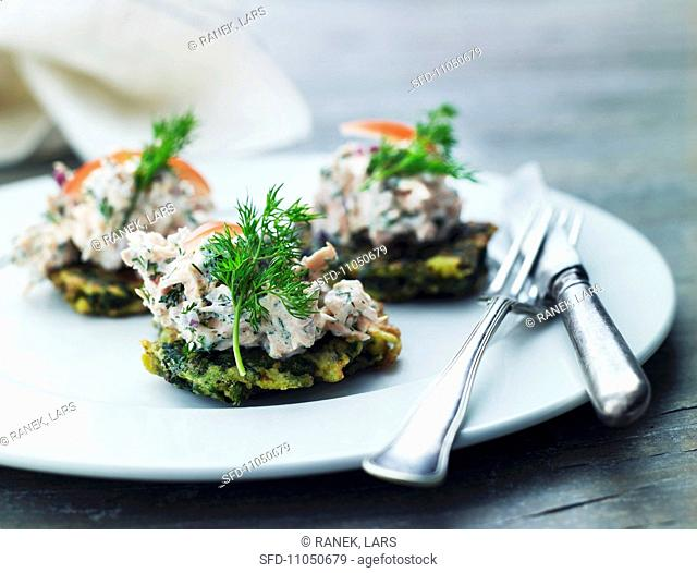 Potato cakes topped with tuna salad