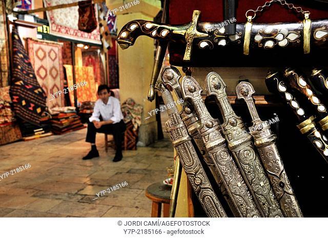 Daggers and vendor . Grand Bazaar. Istanbul. Turkey