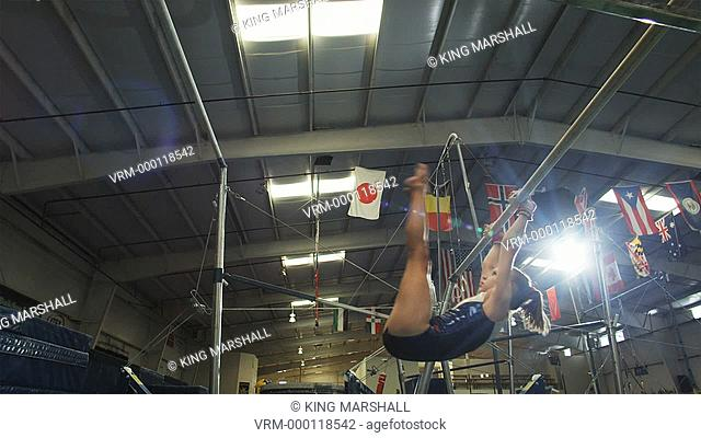 WS Girl 12-13 performing gymnastics on the high bar / Lindon, Utah, USA