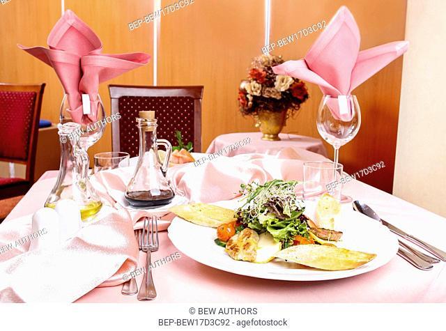 Caesar salad. Dinner in elegant restaurant