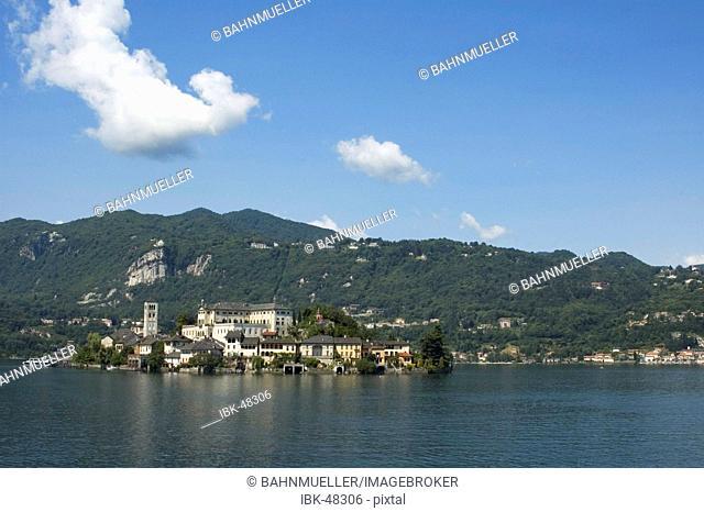 Orta San Giulio at the Lake Orta Lago di Orta Piedmont Piemonte Italy view over the lake to the island S. Giulio with the monastery