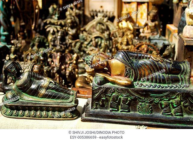Reclining Buddha statues at shop ; Jaisalmer ; Rajasthan ; India