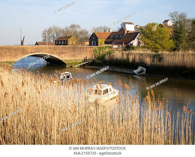 Reed beds by bridge and maltings buildings, River Alde, Snape, Suffolk, England