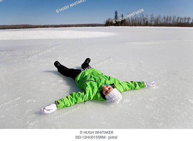 Woman Lying on Frozen Lake