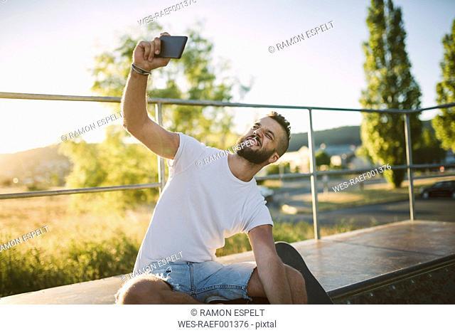 Skateboarder taking selfie