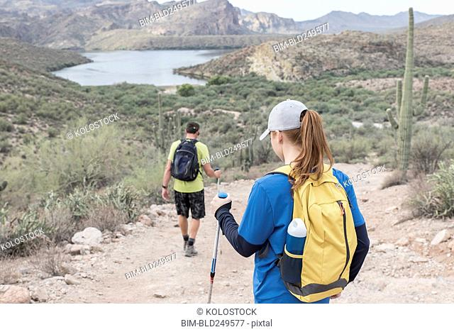 Couple hiking on rocky path in desert
