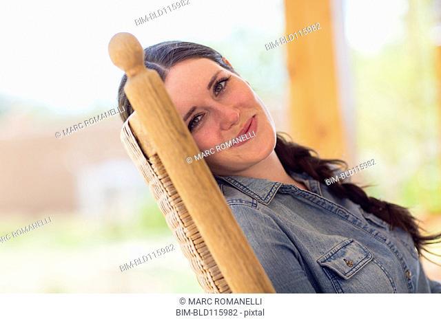 Caucasian woman relaxing in rocking chair