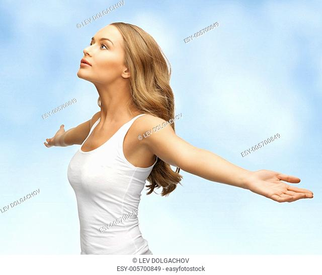 picture of happy woman spreading hands over blue sky