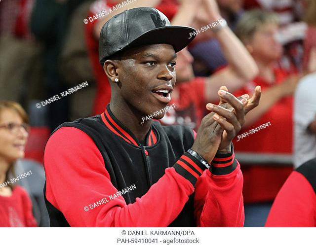 NBA player Dennis Schroeder of the Atlanta Hawks watches the German Bundesliga basketball playoff final between Brose Baskets Bamberg and Bayern Munich...