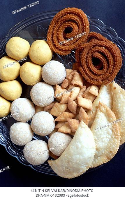 Besan Ladoo ; Rava Ladoo ; Karanji ; Shankarpali and Bhajani Chakli ; Homemade Maharashtrian Food made for Diwali Deepavali festival ; Mumbai Bombay ;...