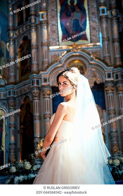Stylish elegant bride on background the old church
