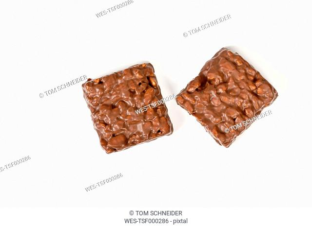 chocolate coated puffed rice on white background