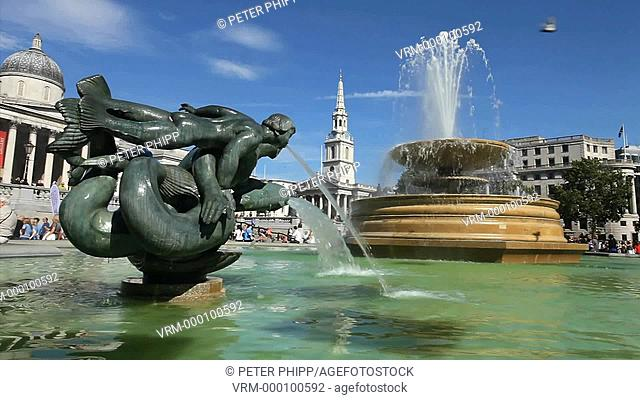 The Fountains in Trafalgar Square in front of the National Portrait Gallery in central London
