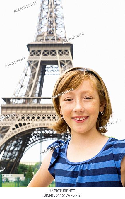 Caucasian girl smiling by Eiffel Tower, Paris, France