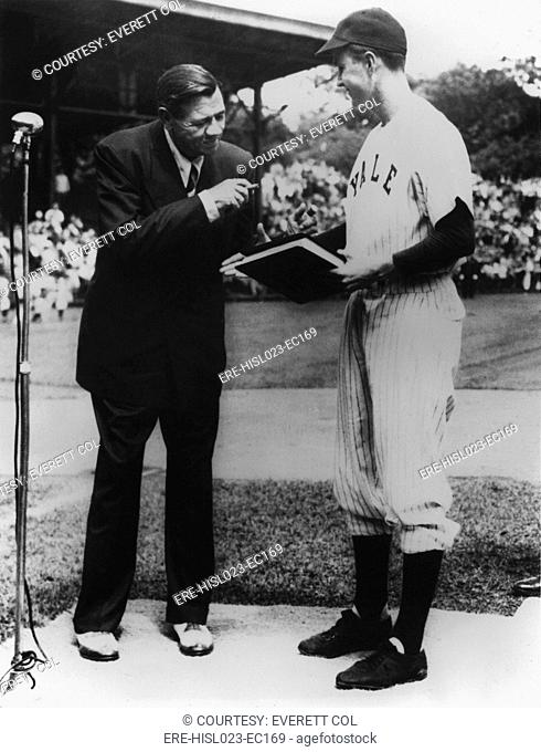 On behalf of Yale University Yale Baseball Captain George Bush accepts the manuscript of THE BABE RUTH STORY his autobiography from Babe Ruth