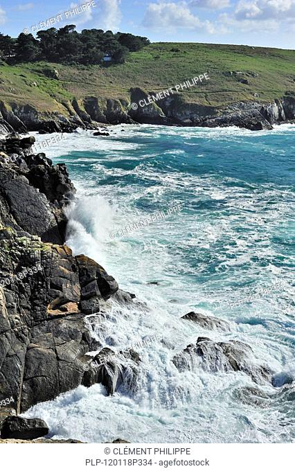 Waves crashing on the rocks of sea cliff at the Pointe du Millier at Beuzec-Cap-Sizun, Finistère, Brittany, France