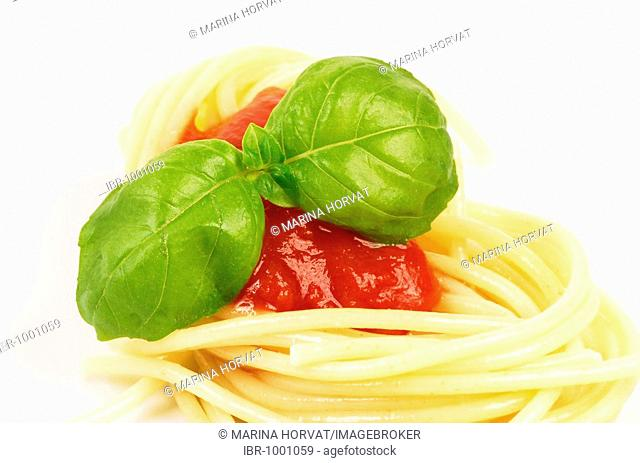 Spaghetti with basil leaves and tomato sauce