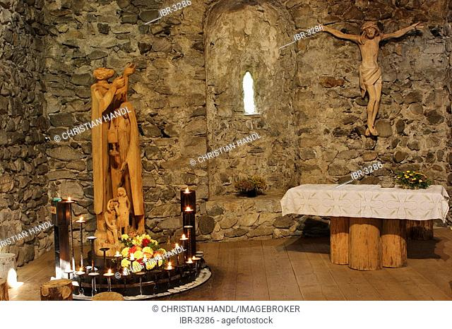 Rebuilt chapel part of the hiking trail with religious sculptures called reflection of the sun song or Franziskus path Sand in Taufers South Tyrol Italy
