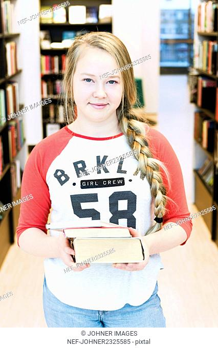 Teenage girl in library