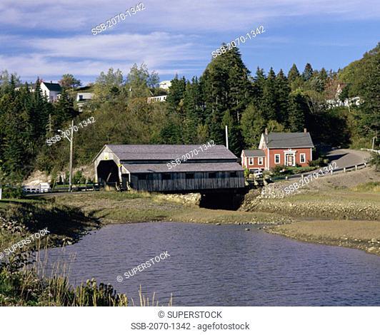 Covered bridge across a stream, St. Martins, New Brunswick, Canada