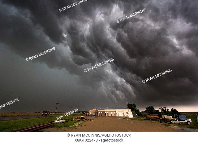 Roiling outflow clouds behind a supercellular thunderstorm producing a tornado near Quinter, Kansas, May 23, 2008
