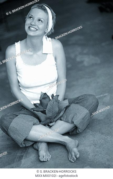 Portrait of young woman sitting on floor