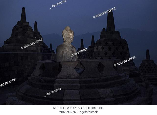 Buddha statue at the Borobudor temple in Java, Indonesia