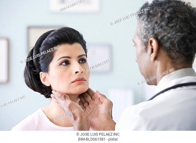 African male doctor examining patient