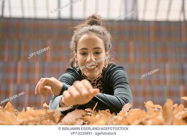 woman, autumn leaves