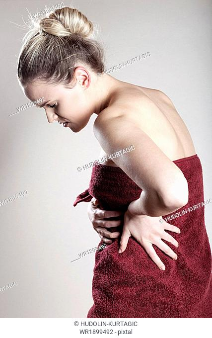 Young woman wrapped in towel