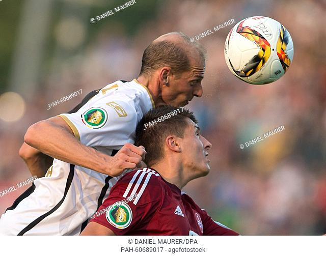 Aalen's Oliver Barth (L) and Nuernberg'sJakub Sylvestr vie for the ball during the German soccer DFBCup first round match between VfR Aalen and 1