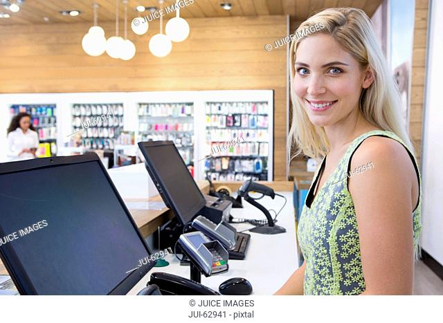 Female store assistant behind counter