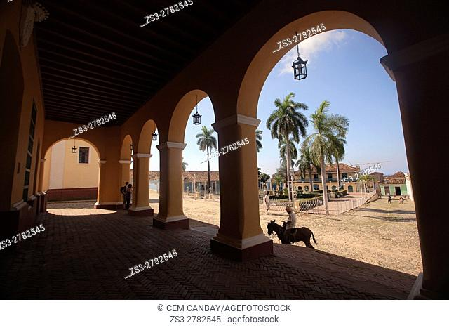 View from Casa de la Cultura to the Plaza Mayor-Main Square in the town center with a man on a donkey in the foreground, Trinidad, Sancti Spiritu Province, Cuba