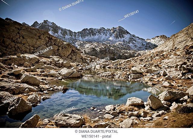 Peaks of Lake at Peguera Valley, Aiguestortes National Park. Pyrenees Mountains. Lleida, Catalonia
